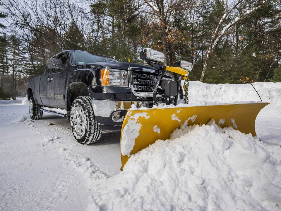 Pickup-truck-plowing-snow